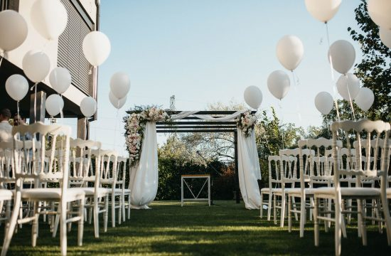 aisle and chair setting at modern outdoor wedding at club reset